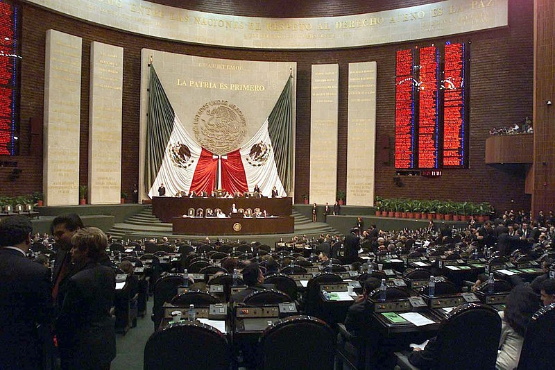 http://upload.wikimedia.org/wikipedia/commons/a/a1/Mexico_Chamber_of_Deputies_backdrop.jpg, By Zscout370 at en.wikipedia [Public domain], from Wikimedia Commons
